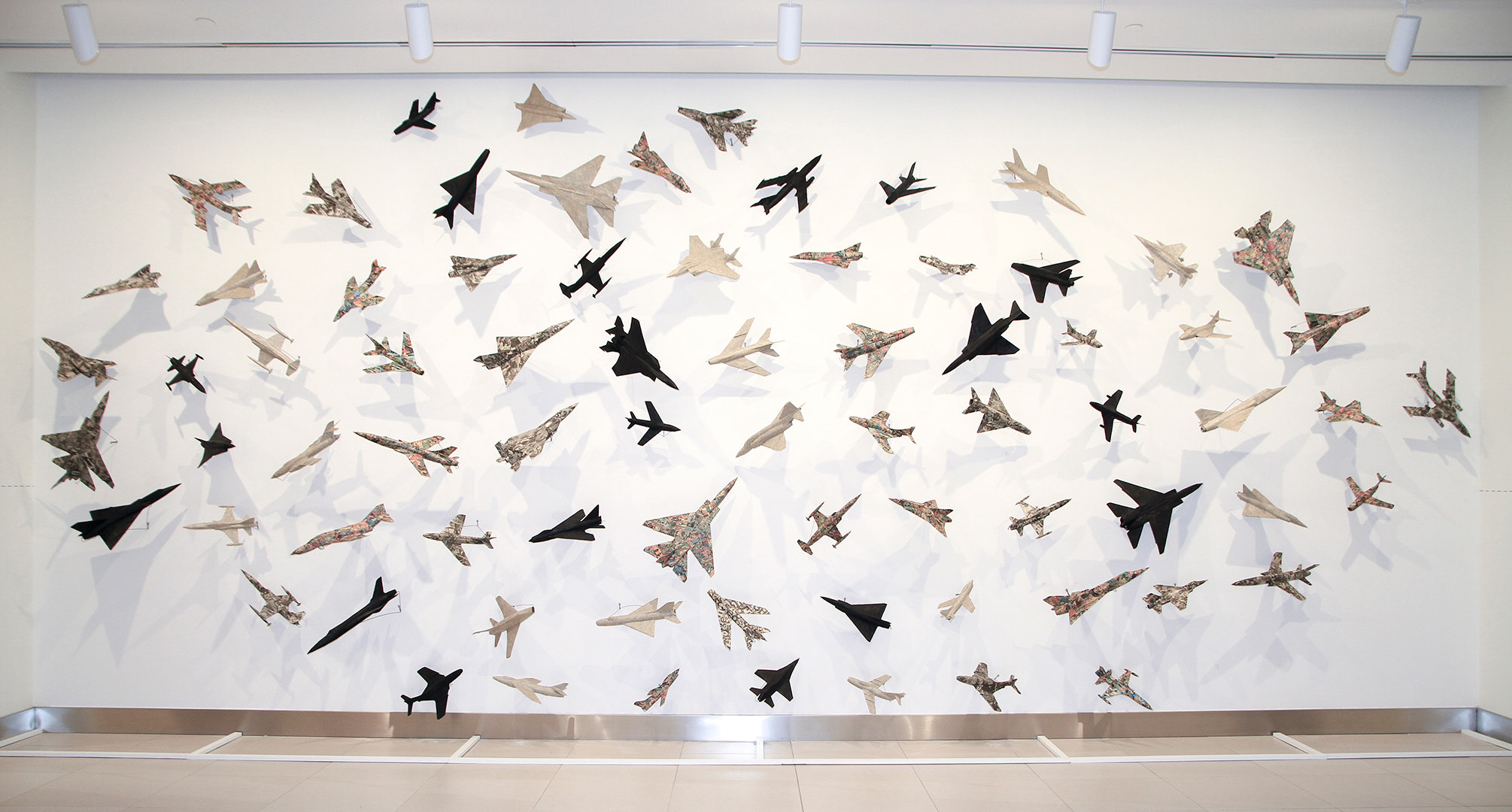 76 Airplanes (1985) Robert Adrian (1935 - 2015) Installation: collage on model airplanes Collection: Canada Council Art Bank