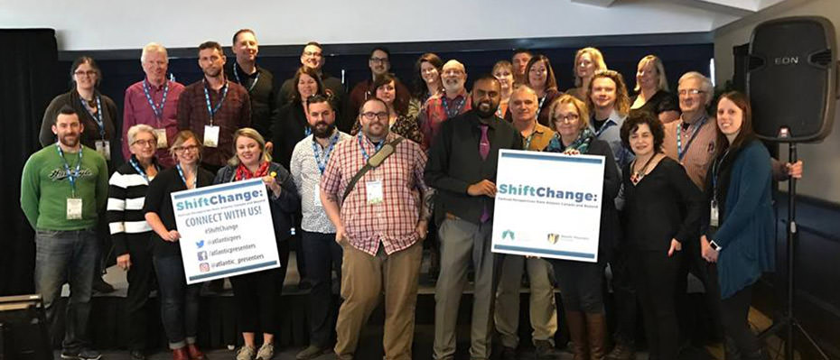 Conference participants at ShiftChange pose for a group photo.