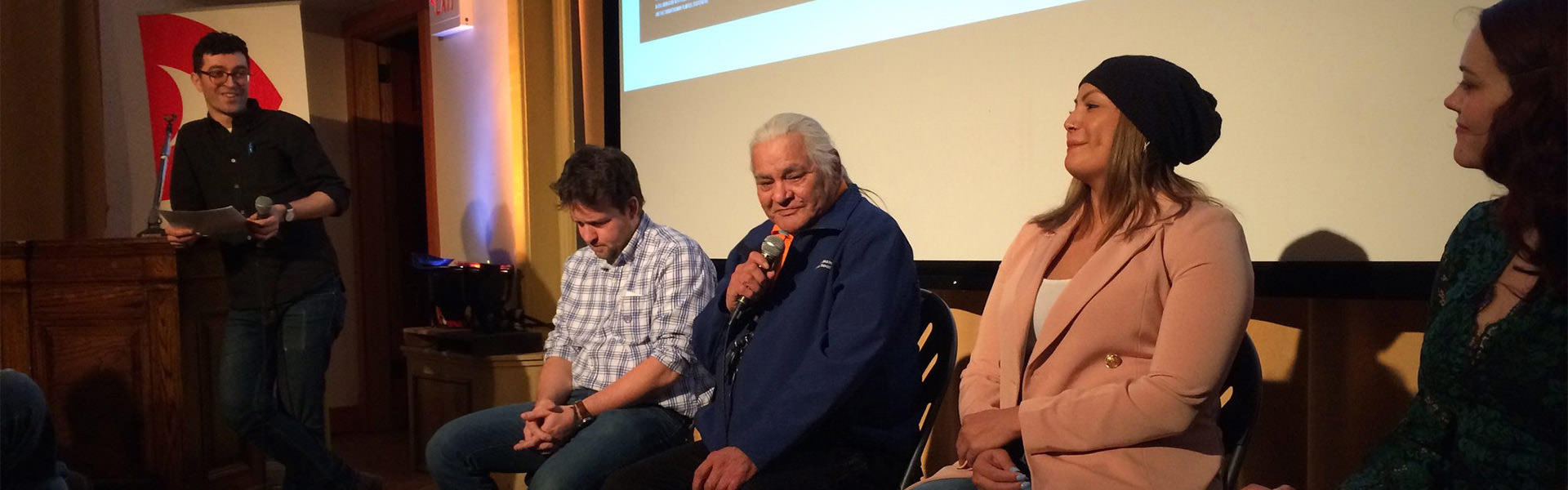 A group of panelists on stage after a screening of To Wake up the Nakota Language at the Doc Lab Saskatchewan.