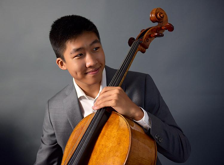 Bryan Cheng, recipient of the 2017 Michael Measures Prize, hold his 1754 Venetian cello by Bartolomeo Tassini.