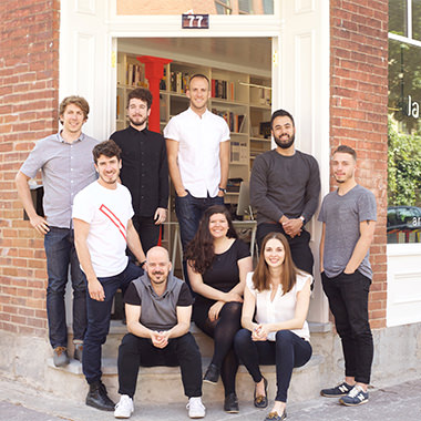 La SHED team stand outside of their office
