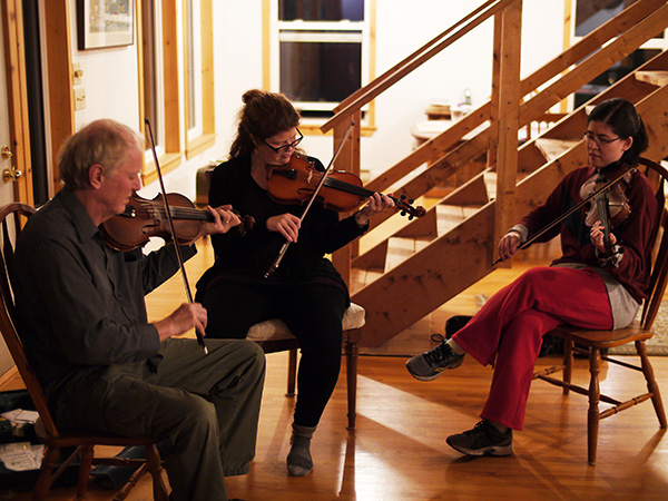 Paul Cranford and Sarah Beck help Maria Millar learn her first Strathspey.