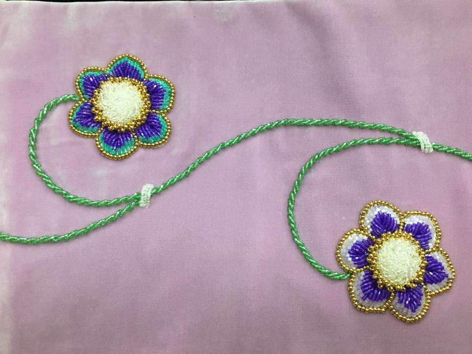Beaded flowers on lilac fabric