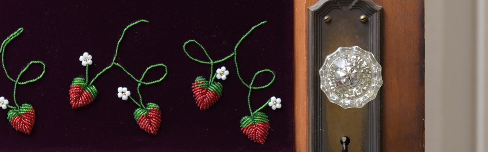 Beaded strawberries on door