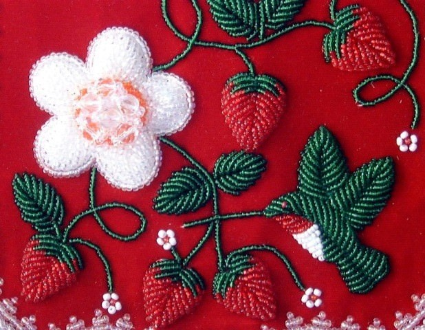 Beaded flowers and strawberries on red fabric