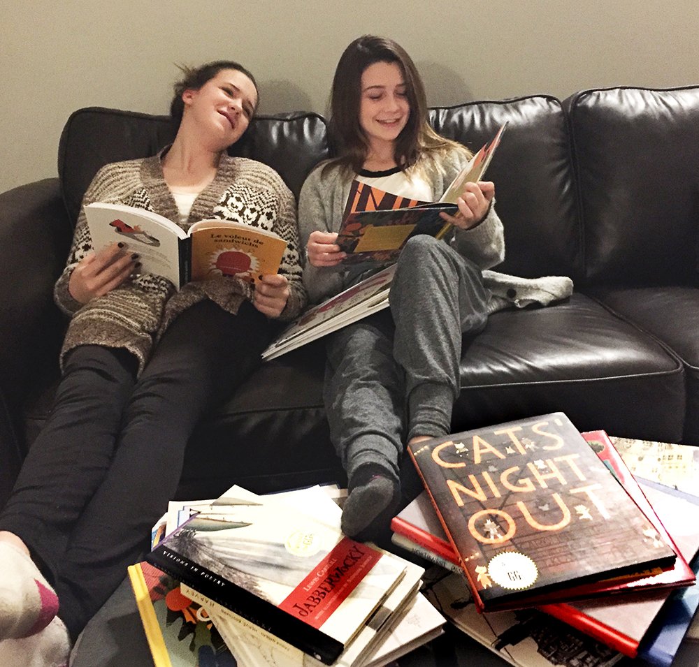 The granddaughters enjoying their books at Christmas. Lily, age 15 (left) is in grade 10 at Citadel High School in Halifax, and Georgia, age 13 (right) is in grade 8 at Halifax Independent School.