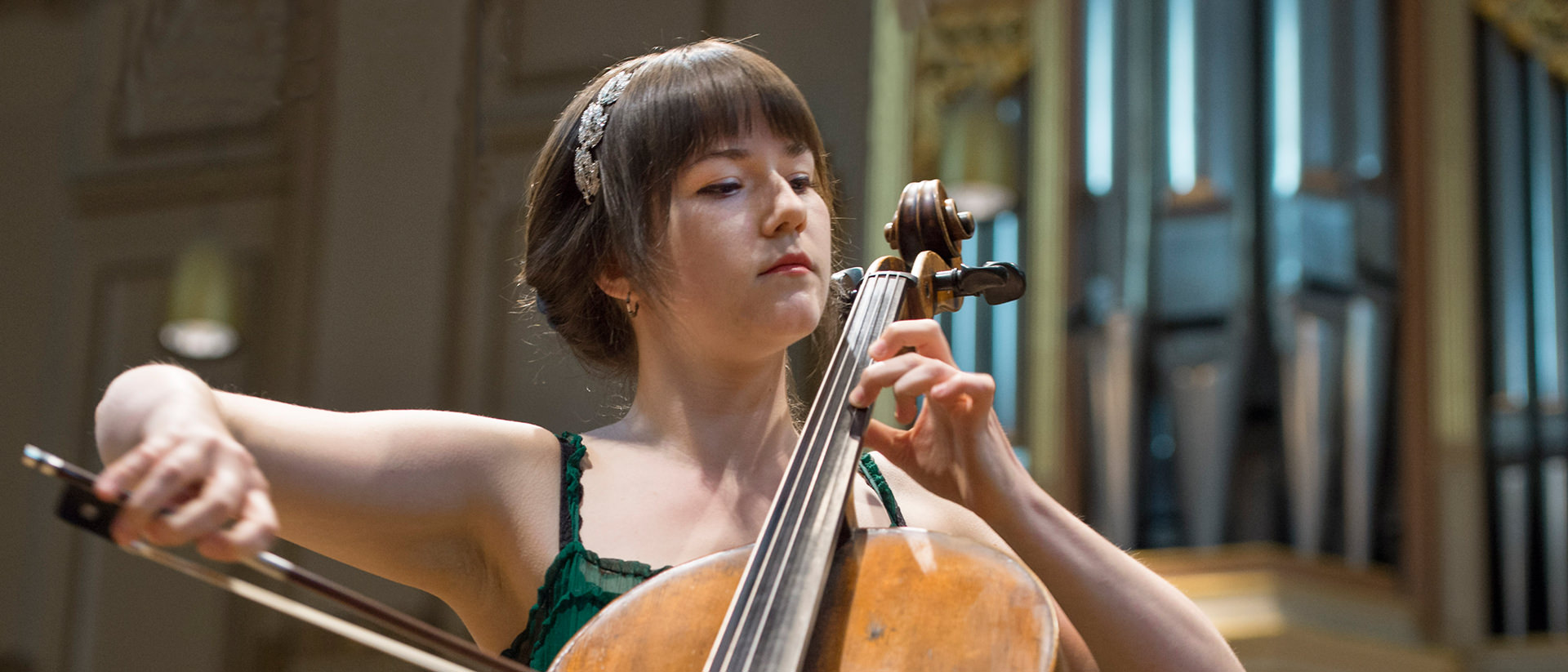 Vanessa Hunt Russell performs on her cello at a chamber music concert