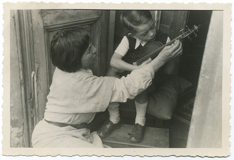 Black and white photo of Sonia Eckhardt-Gramatté with a child playing the Eckhardt-Gramatté Joachim George Chanot violin