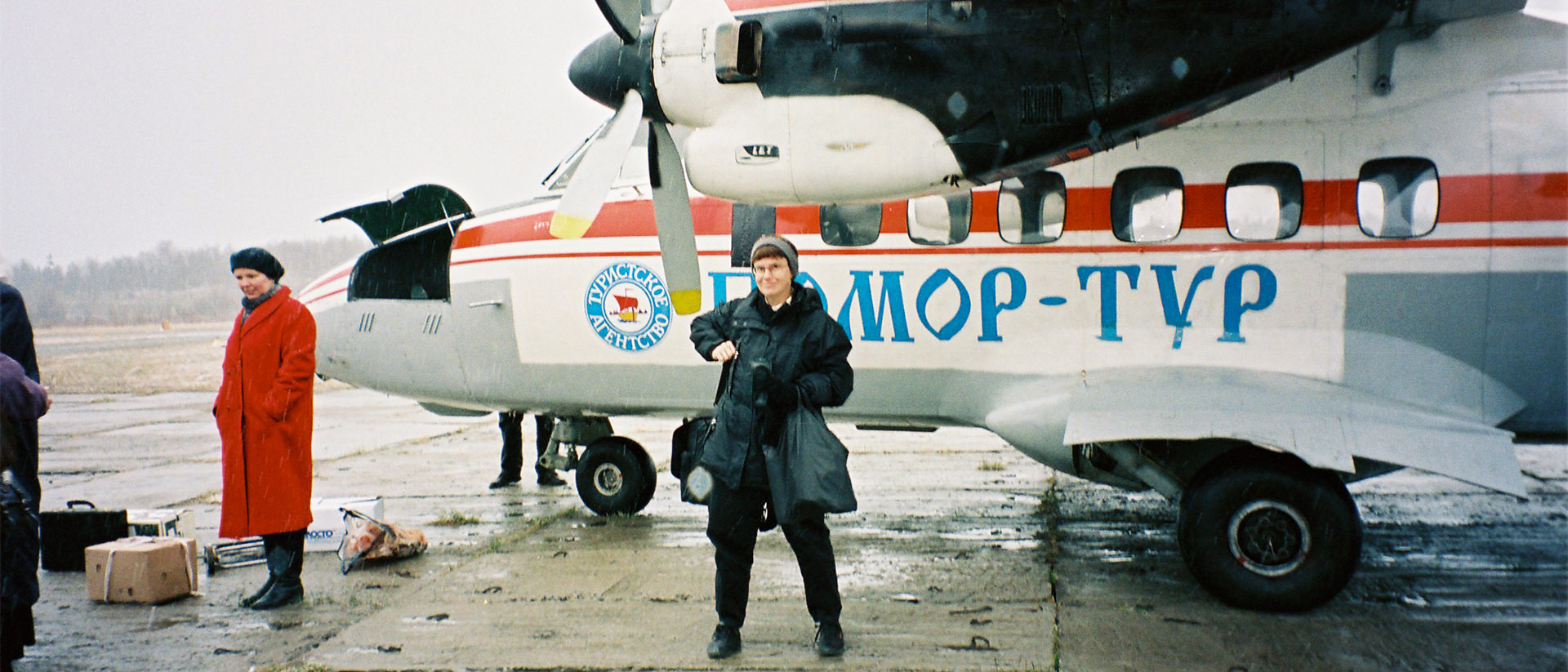 Lynne Viola stands next to a single-engine propeller plane during a research trip to Russia