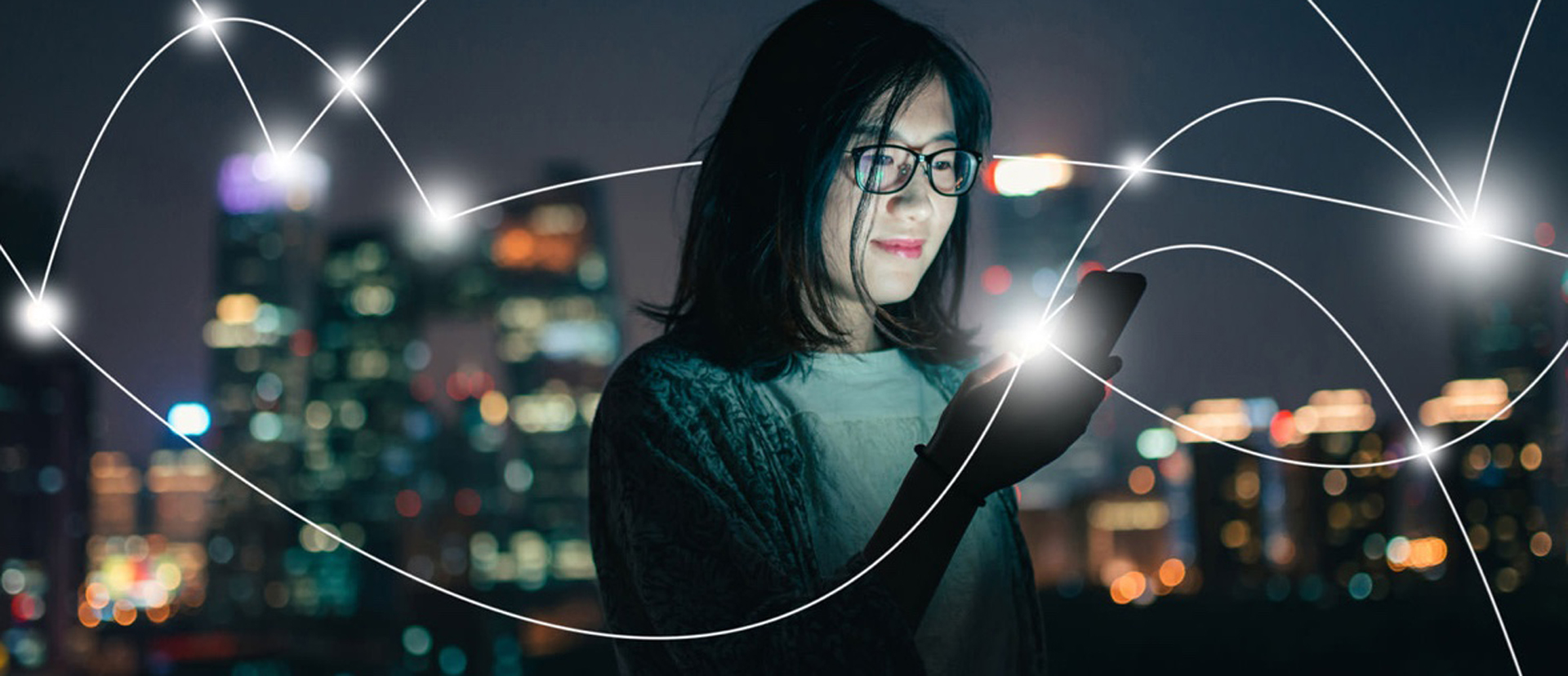 Woman holds phone surrounded by streaks of light